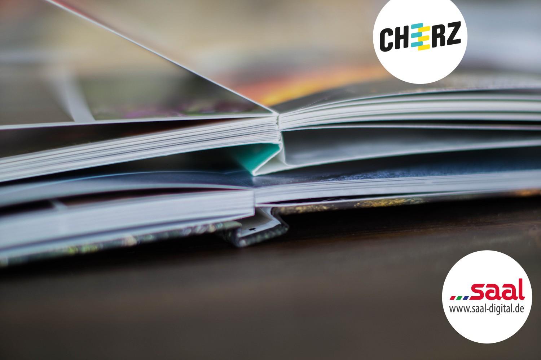 Fotobuch Cheerz Saal-Digital Vergleich Fotoalbum Logo 4