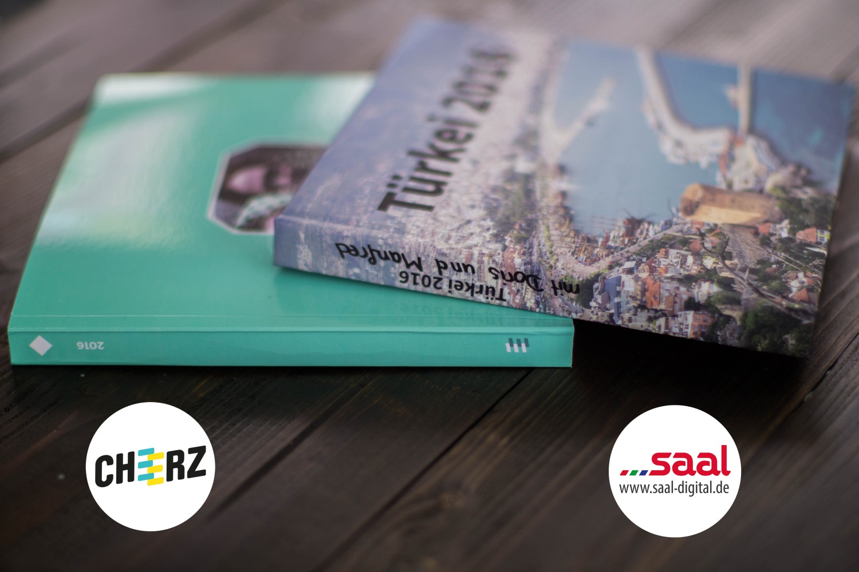 Fotobuch Cheerz Saal-Digital Vergleich Fotoalbum Logo 8
